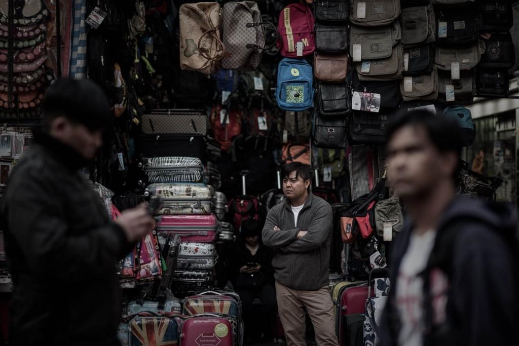 Man outside his shop
